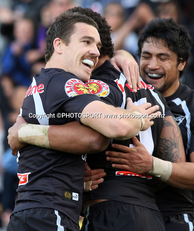 Warriors players Michael Witt and Jerome Ropati celebrate with Manu Vatuvei. NRL, Vodafone Warriors v Penrith  Panthers, Mt Smart Stadium, Auckland, Sunday 31 August 2008. Photo: Andrew Cornaga/PHOTOSPORT