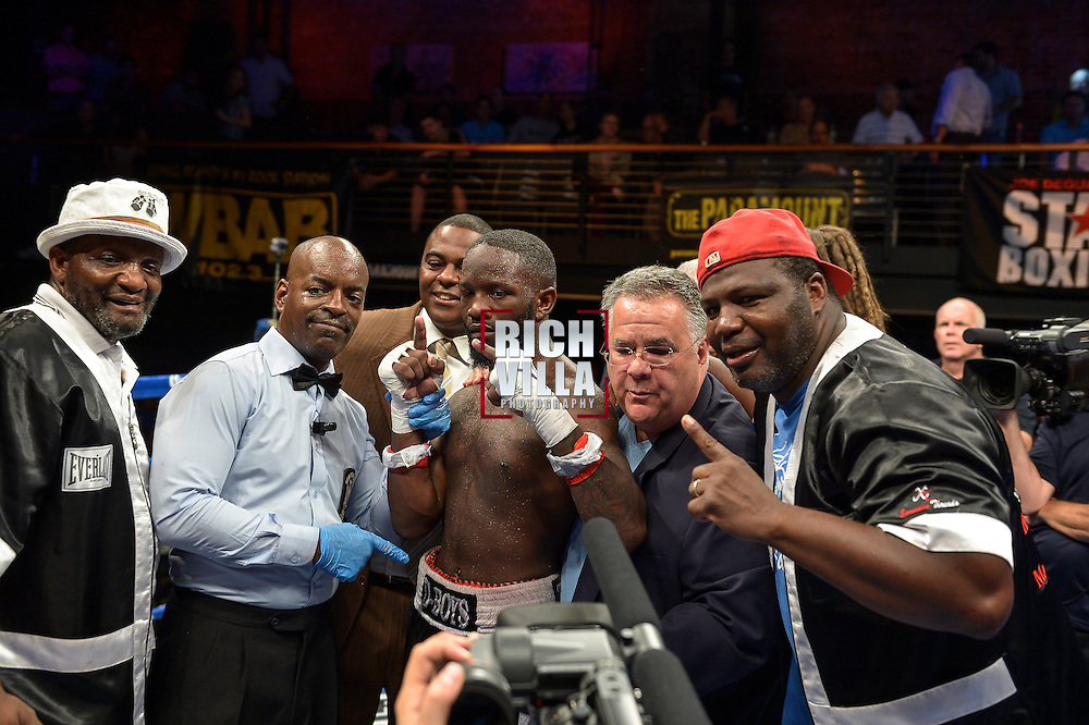 Emanuel Taylor(red tape) gets the unanimous decision over Karim Mayfield(white tape) at The Paramount Theater in Huntington, NY for ESPN's Friday Night Fights on July 18th, 2014