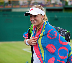 LONDON, ENGLAND - Monday, June 29, 2009: Sabine Lisicki (GER) celebrates after her Ladies' Singles 4th Round match on day seven of the Wimbledon Lawn Tennis Championships at the All England Lawn Tennis and Croquet Club. (Pic by David Rawcliffe/Propaganda)