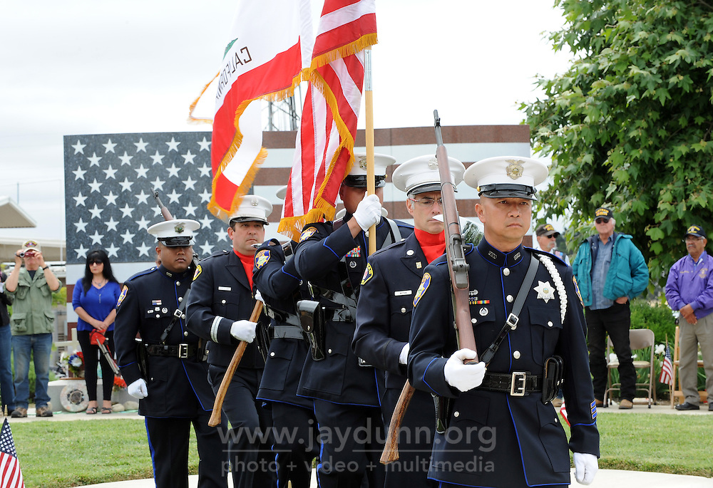 An honor guard from the Salinas fire and police departments marches during the Memorial Day ceremony on Monday at the Monterey County Vietnam Veterans Memorial in Salinas.