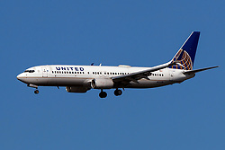 Boeing 737-824 (N12218) operated by United Airlines on approach to San Francisco International Airport (KSFO), San Francisco, California, United States of America