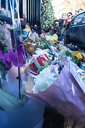 Highgate, London, December 26th 2016. Fans gather outside the London home of pop icon George Michael who died on Christmas day. PICTURED: Flowers stack up against the gate.