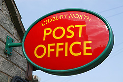 Sign on side of post office,
