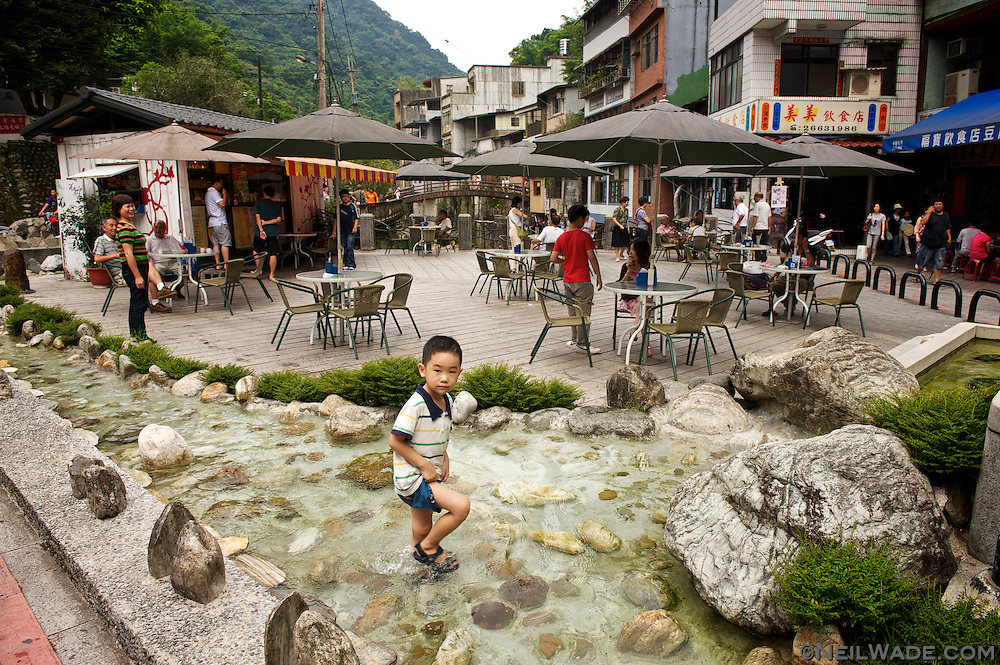The main square of Shiding has a nice square to sit and relax, or dip your toes in the cool water from the river.