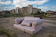 July 17, Eastern New Orleans, Discarded furniture in front of abandoned housing projects destroyed by Hurricane Katrina in 2005.