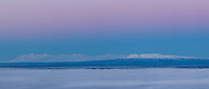 Composite panorama of twilight on Mount Spur and Mount Susitna before sunrise in Southcentral Alaska. Winter. Morning.