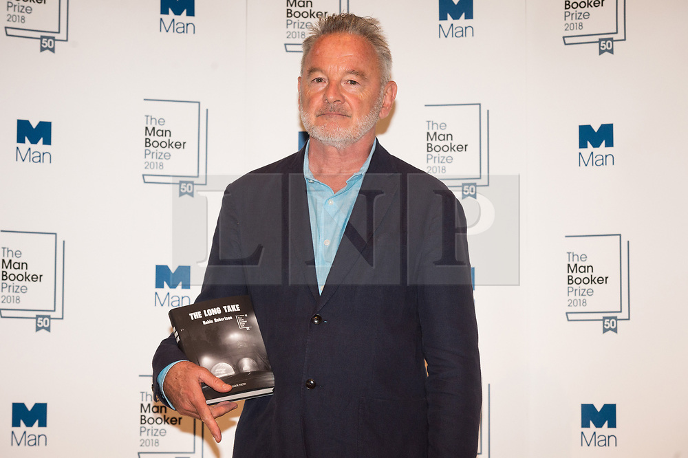 © Licensed to London News Pictures. 14/10/2018. London, UK. Author Robin Robertson poses with his book The Long Take during a photocall at the Royal Festival Hall, two days ahead of the announcement of the winning book of the 2018 Man Booker Prize. Six novelists have been shortlisted for the 2018 Man Booker Prize, a literary prize awarded for the best original novel in English credit: PhotoRay Tang/LNP