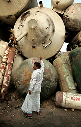 BANGLADESH MADHOM BIBIR HAT 6MARB05 - Salvaged pressure tanks from ocean-going vessels are for sale at one of the secondary businesses selling hardware recovered from shipbreaking yards at Madhom Bibir Hat outside Chittagong, Bangladesh. ..jre/Photo by Jiri Rezac..© Jiri Rezac 2005..Contact: +44 (0) 7050 110 417.Mobile: +44 (0) 7801 337 683.Office: +44 (0) 20 8968 9635..Email: jiri@jirirezac.com.Web: www.jirirezac.com..© All images Jiri Rezac 2005 - All rights reserved.
