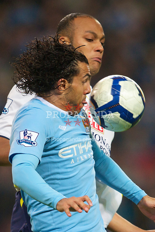 MANCHESTER, ENGLAND - Wednesday, May 5, 2010: Manchester City's Carlos Tevez and Tottenham Hotspur's Younes Kaboul during the Premiership match at City of Manchester Stadium. (Photo by David Rawcliffe/Propaganda)
