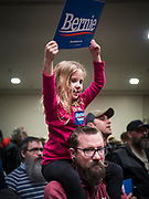 02 MARCH 2020 - ST. PAUL, MINNESOTA: ERIK LANDSVERK holds his daughter, ETTA LANDSVERK, 6 years old, on his shoulders at a Bernie Sanders Get Out the Vote rally in the RiverCentre in St. Paul. More than 8,400 people attended the rally. Minnesota is a Super Tuesday state this year and Minnesotans will go to the polls Tuesday. Minnesota Sen. Amy Klobuchar was expected to win her home state, but she dropped out early Monday, March 2.         PHOTO BY JACK KURTZ