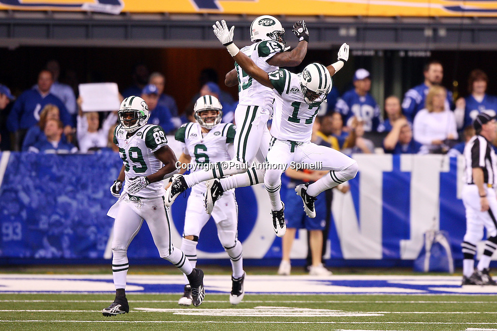 New York Jets wide receiver Braylon Edwards (17) leaps and celebrates with Jets wide receiver Wallace Wright (15) after Edwards catches an 80 yard touchdown pass that gives the Jets a 7-3 second quarter lead during the AFC Championship football game against the Indianapolis Colts, January 24, 2010 in Indianapolis, Indiana. The Colts won the game 30-17. ©Paul Anthony Spinelli