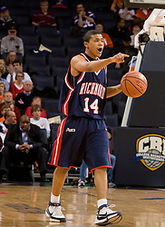 Richmond guard Kevin Anderson (14) sets his offense against Virginia.  The Virginia Cavaliers men's basketball team defeated the Richmond Spiders 66-64 in the first round of the College Basketball Invitational (CBI) tournament held at the University of Virginia's John Paul Jones Arena in Charlottesville, VA on March 18, 2008.