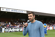 Mark Wood, England's Cricket Ashes Test Hero is guest of honour, during the Sky Bet League 2 match between AFC Wimbledon and Exeter City at the Cherry Red Records Stadium, Kingston, England on 29 August 2015. Photo by Stuart Butcher.