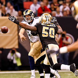 December 12, 2010; New Orleans, LA, USA; St. Louis Rams quarterback Sam Bradford (8) throws under pressure by New Orleans Saints linebacker Marvin Mitchell (50) during the first half at the Louisiana Superdome. Mandatory Credit: Derick E. Hingle-US PRESSWIRE