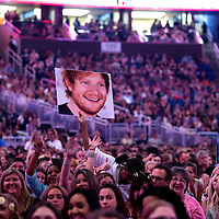 Fans hold up a poster of musician Ed Sheeran prior to his performance at the Amway Center on Tuesday, September 8, 2015 in Orlando, Florida.  (Alex Menendez via AP)