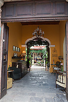 Taking a peak inside one of the many beautiful old buildings in Antigua, Guatemala.