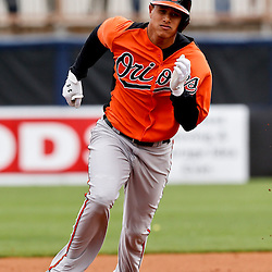 Mar 2, 2013; Port Charlotte, FL, USA; Baltimore Orioles third baseman Manny Machado (13) heads for third base on a triple hit against the Tampa Bay Rays during the top of the sixth inning of a spring training game at Charlotte Sports Park. Mandatory Credit: Derick E. Hingle-USA TODAY Sports