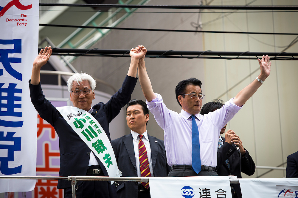 TOKYO, JAPAN - JULY 6 : Katsuya Okada President of Democratic Party of Japan (DPJ) and his party candidate Toshio Ogawa greets their supporters during the Upper House election campaign outside of Machiya Station, Tokyo prefecture, Japan, on July 6, 2016. (Photo by Richard Atrero de Guzman/NUR Photo)