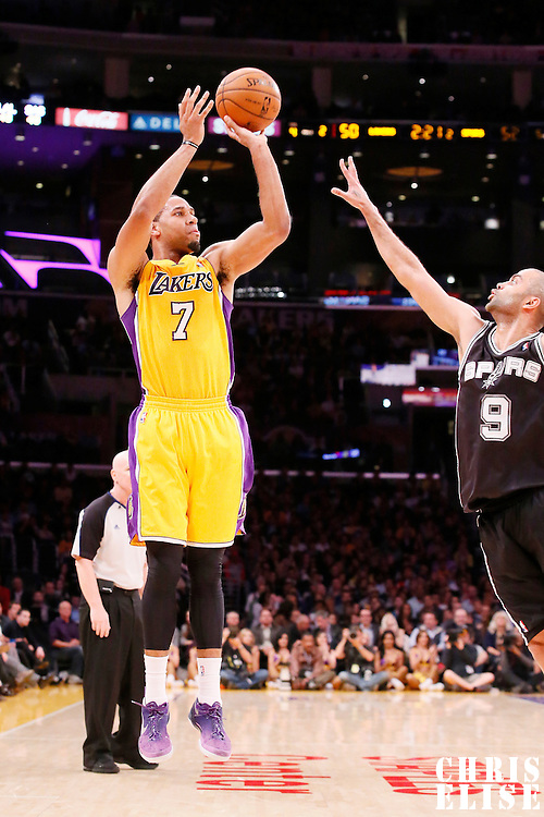 19 March 2014: Los Angeles Lakers forward Xavier Henry (7) takes a jump shot over San Antonio Spurs guard Tony Parker (9) during the San Antonio Spurs 125-109 victory over the Los Angeles Lakers at the Staples Center, Los Angeles, California, USA.