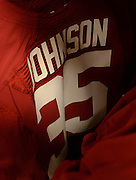 Equipment managers work in the Mal Moore Athletic Facility to get the University of Alabama football team ready for the trip to Baton Rouge to face LSU.  Nico Johnson's jersey hangs in the equipment room.  Photo by Gary Cosby Jr.