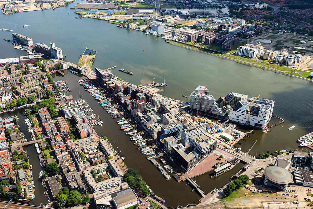 Nederland, Noord-Holland, Amsterdam, 14-06-2012; Zicht op het IJ met Westerdok en Amsterdam-Noord. Westerdoksdijk, Westerdok, Stenen Hoofd en Silodam. Op het kunstmatige schiereiland IJDock, toekomstige huisvesting van onder andere het Gerechtshof van Amsterdam, Dienst Waterpolitie van het Korps Landelijke Politiediensten (KLPD).  ..View on the IJ (water)  and the north bank Amsterdam North (top picture) . Urban renewal in Amsterdam West and North, mainly residential houses, but  for creative entreprises. The home offices for the Amsterdam Court of appeal and the police are constructed on a artificial isle. luchtfoto (toeslag), aerial photo (additional fee required).foto/photo Siebe Swart