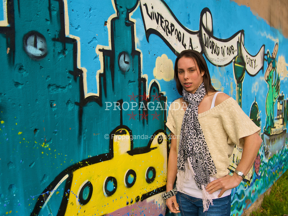 LIVERPOOL, ENGLAND - Friday, October 23, 2009: Cheshire gymnast Beth Tweddle, who won gold at the World Artistic Gymnastics Championship, photographed in front of wall of graffiti in the city of Liverpool where she trains. (Pic by David Rawcliffe/Propaganda)