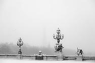France. Paris under the snow.. Alexandre III 3 and the Eiffel Tower / Pont Alexandre III et la tour Eiffel , Paris sous la neige en hiver