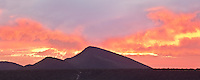 A fiery sunset appears to pour out of this mountian in the Sonoran Desert. Ocotillo Hill, Cave Creek, Arizona