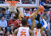 SAN DIEGO, CA - MARCH 16:  Johnny McCants #35 of the New Mexico State Aggies contests a shot from Shelton Mitchell #4 of the Clemson Tigers during a first round game of the Men's NCAA Basketball Tournament at Viejas Arena in San Diego, California. Clemson won 79-68.  (Photo by Sam Wasson)