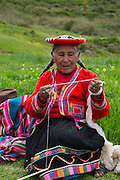 Quechua woman weaving, Inca terraces of Moray,  Cusco Region, Urubamba Province, Machupicchu District, Peru