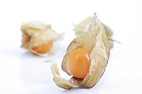 Close-up of physalis fruit on white background
