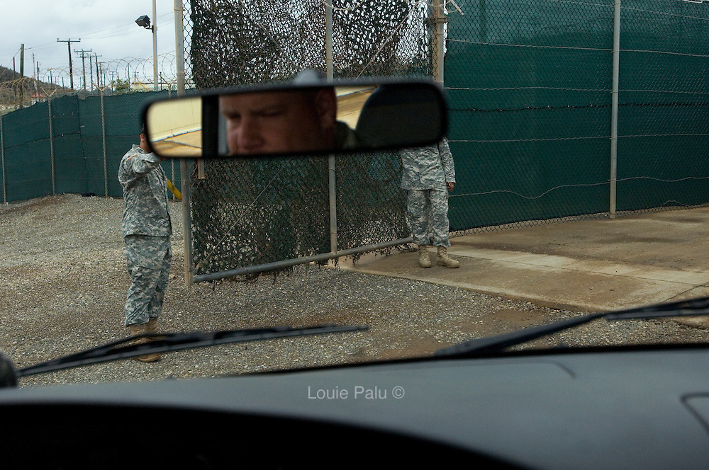 """Members of the U.S. walk open a gate for a driver of a vehicle to the entrance at Camp Delta at the Guantanamo Bay detention facility. The U.S. Government is currently holding approximately 340 """"enemy combatants"""" in Guantanamo Bay, Cuba. They were captured during the """"Global War on Terrorism"""" after the attacks on the United States on September 11, 2001. This photo was reviewed by a U.S. Military official before transmission."""
