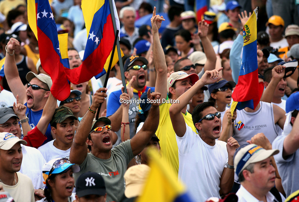 Supporters of opposition presidential candidate Manuel Rosales shout slogans of support at the closing campaign rally in Caracas on Saturday November 25, 2006. (Photo/Scott Dalton)