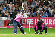 Eoin Morgan of Middlesex hits the ball over the boundary for six runs during the Vitality T20 Blast South Group match between Somerset County Cricket Club and Middlesex County Cricket Club at the Cooper Associates County Ground, Taunton, United Kingdom on 30 August 2019.
