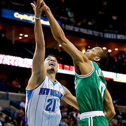 Mar 20, 2013; New Orleans, LA, USA; Boston Celtics point guard Avery Bradley (0) blocks a shot by New Orleans Hornets point guard Greivis Vasquez (21) during the first quarter of a game at the New Orleans Arena. Mandatory Credit: Derick E. Hingle-USA TODAY Sports