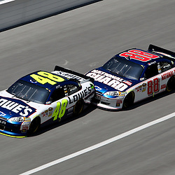 April 17, 2011; Talladega, AL, USA; NASCAR Sprint Cup Series driver Dale Earnhardt Jr. (88) drafts Jimmie Johnson (48) during the Aarons 499 at Talladega Superspeedway.   Mandatory Credit: Derick E. Hingle