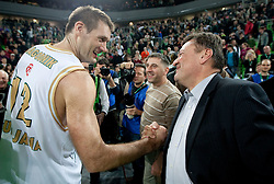 Goran Jagodnik (12) of Olimpija and mayor of Ljubljana Zoran Jankovic celebrate after winning the basketball match between KK Union Olimpija (SLO) and Armani Jeans Milano (ITA) in Group D of Turkish Airlines Euroleague, on December 2, 2010 in SRC Stozice, Ljubljana, Slovenia. Union Olimpija defeated AJ Milano 82-75 and qualified to 16 best teams of Euroleague.  (Photo By Vid Ponikvar / Sportida.com)