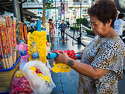 19 AUGUST 2015 - BANGKOK, THAILAND: A vendor sets up her garland stand on the first day the Erawan Shrine was reopen in Bangkok. Erawan Shrine in Bangkok reopened Wednesday morning after more than 20 people were killed and more than 100 injured in a bombing at the shrine Monday, August 17, 2015. The shrine is a popular tourist attraction in the center of Bangkok's high end shopping district and is an important religious site for Thais. No one has claimed responsibility for the bombing.       PHOTO BY JACK KURTZ