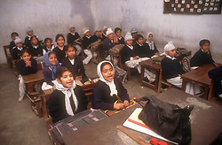 School girls and boys sitting at desks in senior secondary modern school; Punjabi University; Patiala; Punjab; India,