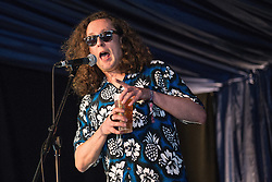"""Image ©Licensed to i-Images Picture Agency. 17/07/2014. Henham Park, Suffolk, United Kingdom. Wonder Stuff front man, Miles Hunt reads from his autobiography """"Miles Hunt: The Wonder Stuff Diaries 1986-1989"""" and plays live acoustic tracks  at the Literary Arena during  Latitude Festival of music and arts . Picture by Joel Goodman / i-Images"""