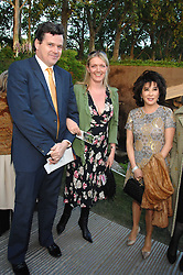 Left to right, PETER BUTLER, his wife ANNABEL she was Annabel Heseltine and LADY LINDA DAVIES host of the eveningat a reception at the gold medal winning De Beers garden in aid of the KT Wong Charitable Trustattending the 2nd day of the 2008 Chelsea Flower show on 20th May 2008.<br />