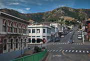 The Port Hills form a backdrop to the view up Oxford St, past neo-classical buildings on Norwich Quay, Lyttelton NZ