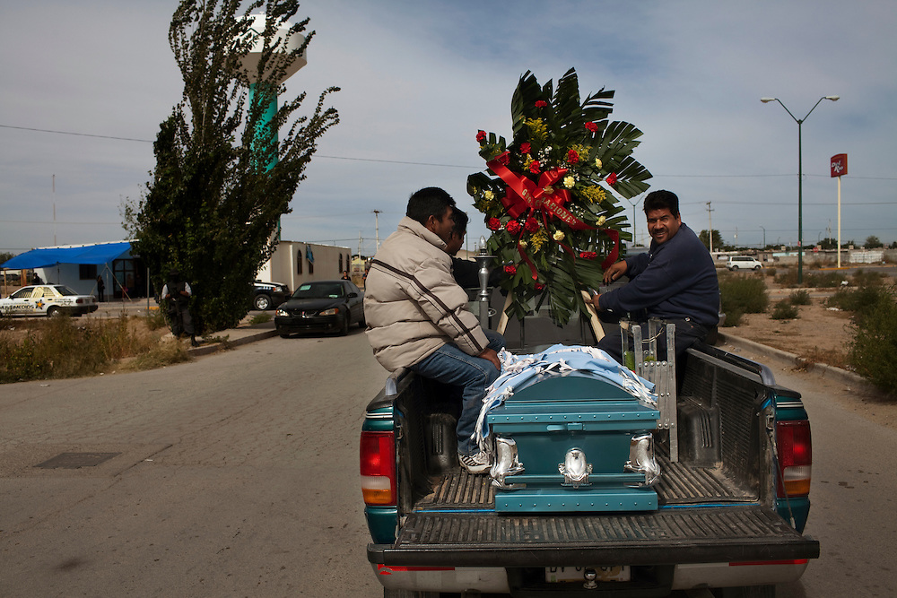 The casket of a teenage victim from a birthday part massacre arrives at the church in Ciudad Juarez.