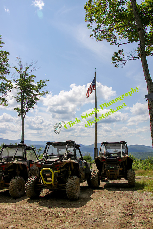 Polaris Rzr's with American Flag flying in front of them, NH, New Hampshire, NH, New England, American Flag, Polaris, Rzr, atv, utv, sxs, ohrv, orv, trail riding, hobby, adventure, sports, therapy, Click Stock Photography