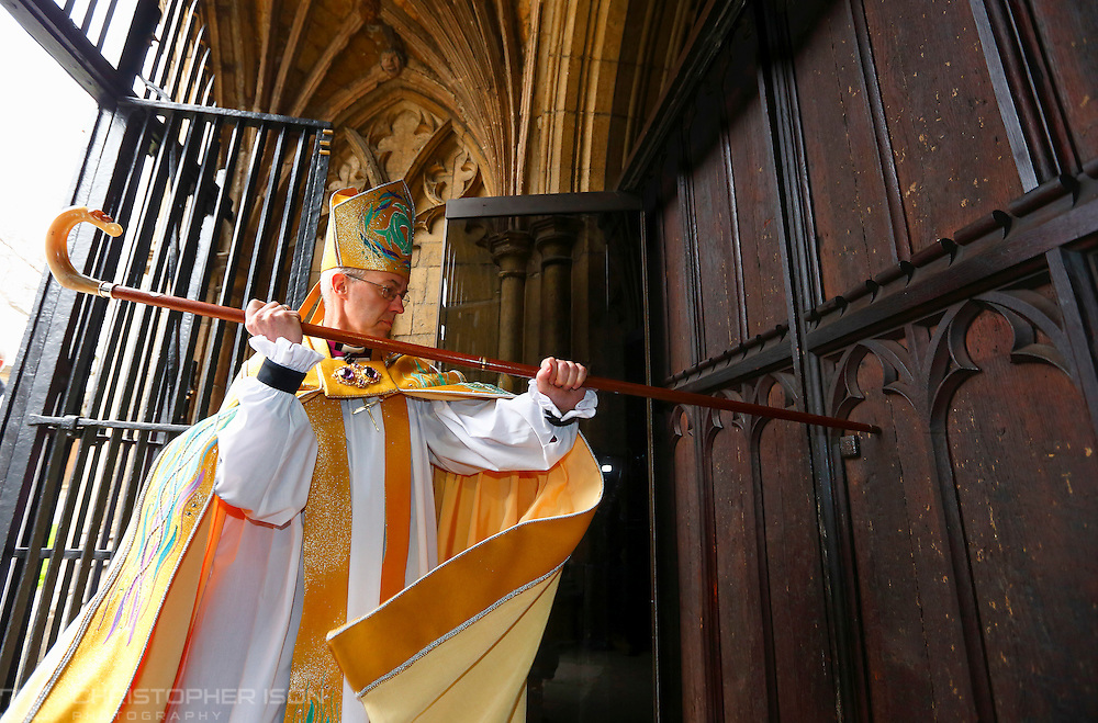 The Archbishop of Canterbury, The Most Reverend Justin Welby, strikes three times on the West Door of Canterbury Cathedral with his pastoral staff prior to his Enthronement.
