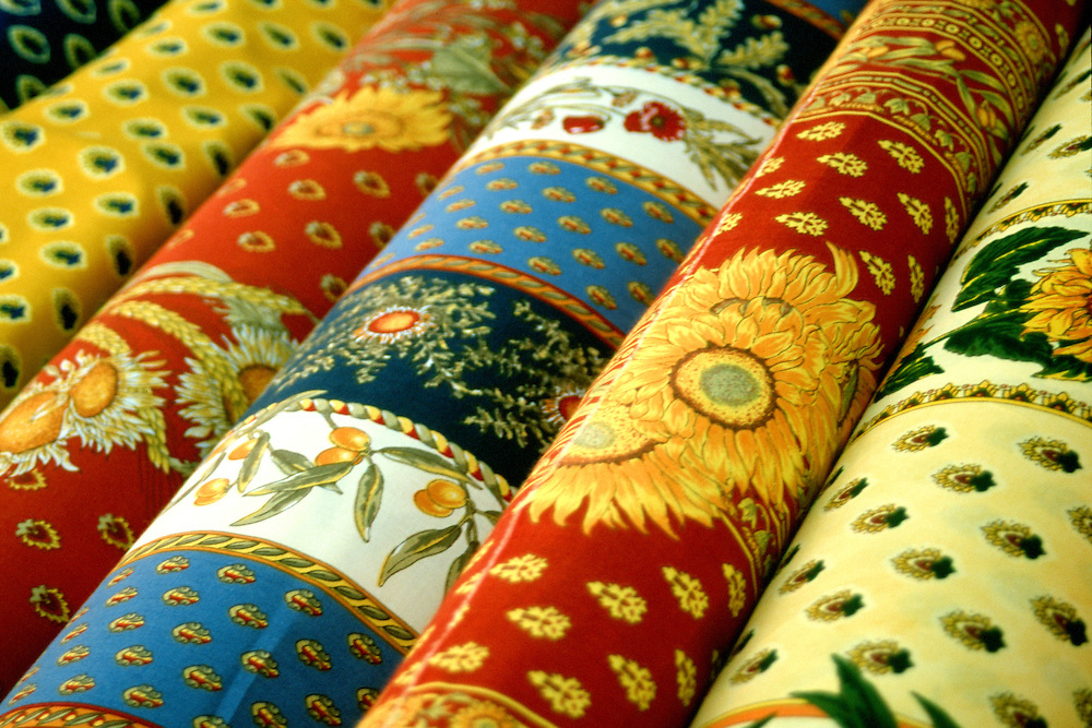 Bolts of Provence cloth for sale, open air market, St. Tropez France