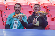 Two gentlemen in the stands with giant , loaded hot dogs during the International Series match between Tennessee Titans and Los Angeles Chargers at Wembley Stadium, London, England on 21 October 2018.