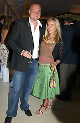 Comedian AL MURRAY and his wife AMBER at a party to celebrate the opening of Maze - a new Gordon Ramsay restaurant at 10-13 Grosvenor Square, London W1 on 24th May 2005.<br />