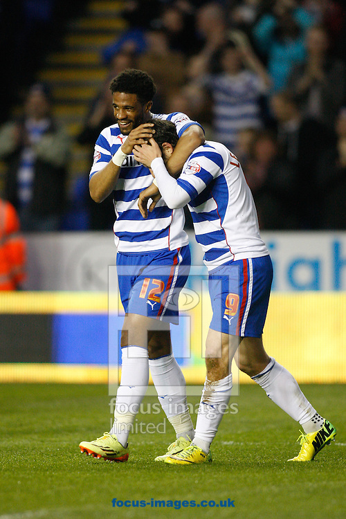 Garath McCleary of Reading (L) congratulates Adam Le Fondre of Reading (R) on his first goal during the Sky Bet Championship match at the Madejski Stadium, Reading<br /> Picture by Andrew Tobin/Focus Images Ltd +44 7710 761829<br /> 22/04/2014