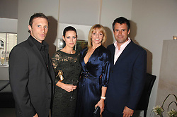 Left to right, PAUL SAMPSON, TV presenter KIRSTY GALLAGHER, TV presenter GABBY LOGAN and her husband KENNY LOGAN at an evening with racing driver Lewis Hamilton held at The Hempel Hotel, 31-35 Craven Hill Gardens, London W2 on 4th July 2007.<br /><br />NON EXCLUSIVE - WORLD RIGHTS